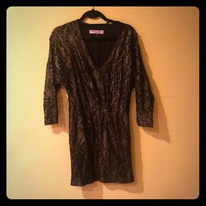 Trina Turk black and gold minidress.